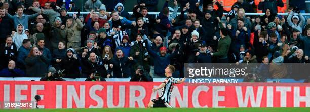 Newcastle United's Scottish midfielder Matt Ritchie celebrates with the crowd after scoring the opening goal during the English Premier League...