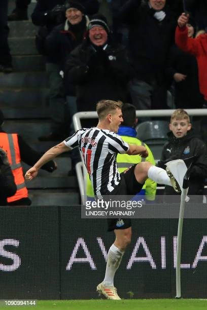 Newcastle United's Scottish midfielder Matt Ritchie kicks the corner flag in celebration after scoring their second goal from the penalty spot during...
