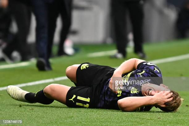Newcastle United's Scottish midfielder Matt Ritchie reacts as he is injured in a challenge with Tottenham Hotspur's Irish defender Matt Doherty...