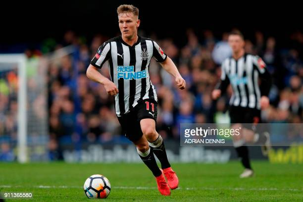 Newcastle United's Scottish midfielder Matt Ritchie runs with the ball during the English FA Cup fourth round football match between Chelsea and...