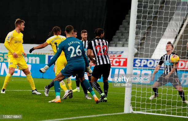 Newcastle United's Scottish midfielder Matt Ritchie scores an own goal during the English Premier League football match between Newcastle United and...