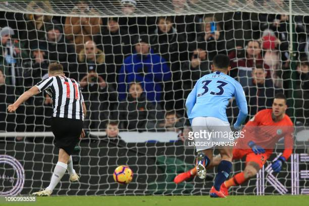 Newcastle United's Scottish midfielder Matt Ritchie scores their second goal from the penalty spot past Manchester City's Brazilian goalkeeper...