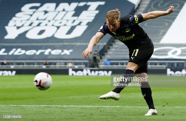 Newcastle United's Scottish midfielder Matt Ritchie shoots towards goal during the English Premier League football match between Tottenham Hotspur...