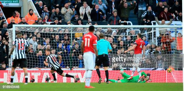 Newcastle United's Scottish midfielder Matt Ritchie wheels away to celebrates after scoring the opening goal during the English Premier League...