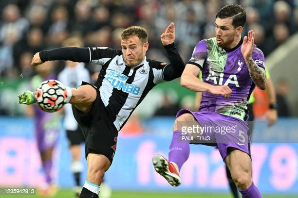 Newcastle United's Scottish midfielder Ryan Fraser shoots as Tottenham Hotspur's Danish midfielder Pierre-Emile Hojbjerg defends during the English...
