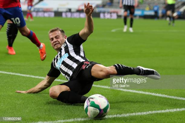 Newcastle United's Scottish midfielder Ryan Fraser stretches for the ball during the English League Cup second round football match between Newcastle...