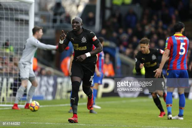 Newcastle United's Senegalese midfielder Mohamed Diame celebrates scoring the team's first goal during the English Premier League football match...