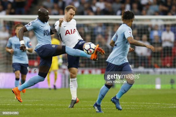 Newcastle United's Senegalese midfielder Mohamed Diame fouls Tottenham Hotspur's Danish midfielder Christian Eriksen during the English Premier...