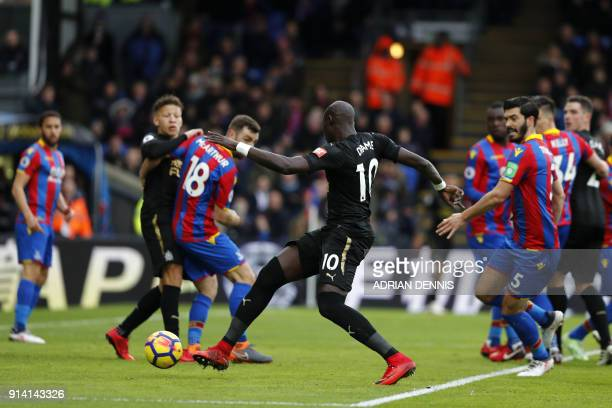 Newcastle United's Senegalese midfielder Mohamed Diame scores the team's first goal during the English Premier League football match between Crystal...