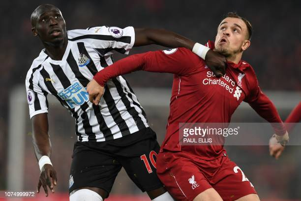 Newcastle United's Senegalese midfielder Mohamed Diame vies with Liverpool's Swiss midfielder Xherdan Shaqiri during the English Premier League...