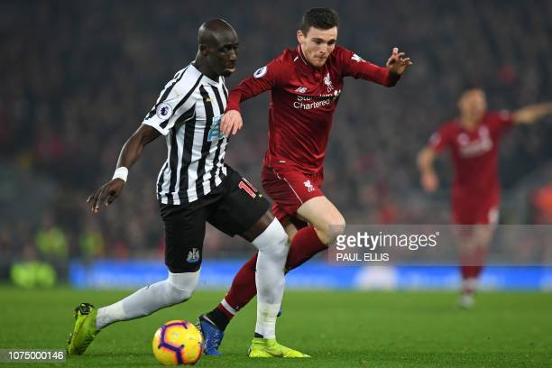 Newcastle United's Senegalese midfielder Mohamed Diame vies with Liverpool's Scottish defender Andrew Robertson during the English Premier League...
