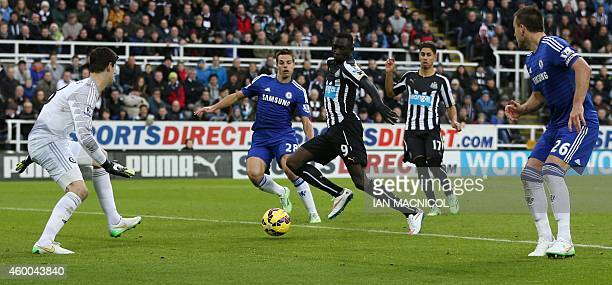 Newcastle United's Senegalese striker Papiss Cisse scores the opening goal past Chelsea's Belgian goalkeeper Thibaut Courtois during the English...