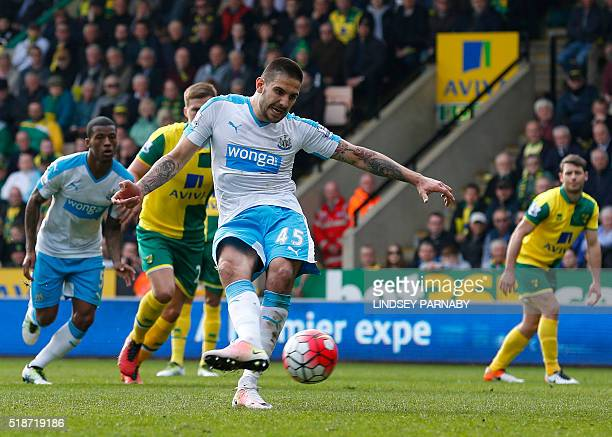 Newcastle Uniteds Serbian striker Aleksandar Mitrovic scores from the penalty spot during the English Premier League football match between Norwich...