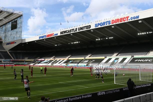 Newcastle United's Slovakian goalkeeper Martin Dubravka concedes a goal by Liverpool's Dutch defender Virgil van Dijk during the English Premier...