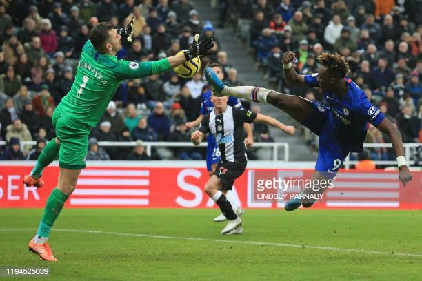 Newcastle United's Slovakian goalkeeper Martin Dubravka saves a shot from Chelsea's English striker Tammy Abraham during the English Premier League...