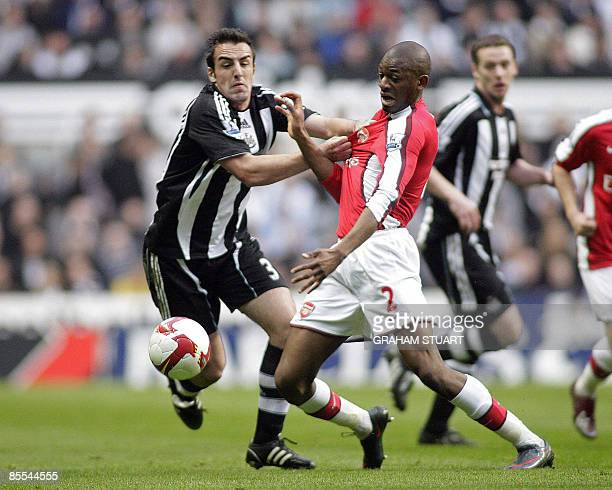 Newcastle United's Spanish defender Sanchez Jose Enrique vies with Arsenal's French player Abou Diaby during an English FA Premier League football...