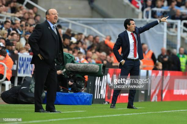 Newcastle United's Spanish manager Rafael Benitez and Arsenal's Spanish head coach Unai Emery shout at their players during the English Premier...