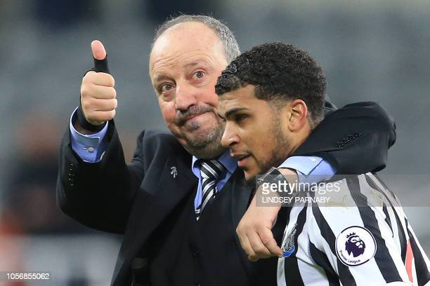 Newcastle United's Spanish manager Rafael Benitez celebrates with Newcastle United's US defender DeAndre Yedlin following the English Premier League...