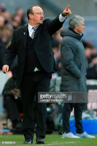 Newcastle United's Spanish manager Rafael Benitez gestures as Manchester United's Portuguese manager Jose Mourinho watches on on the touchline during...