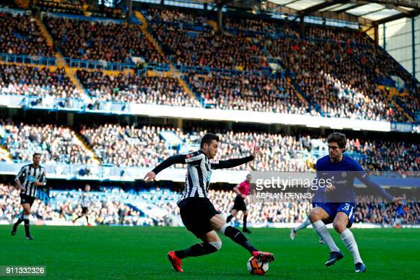 Newcastle United's Spanish midfielder Javier Manquillo vies with Chelsea's Spanish defender Marcos Alonso during the English FA Cup fourth round...
