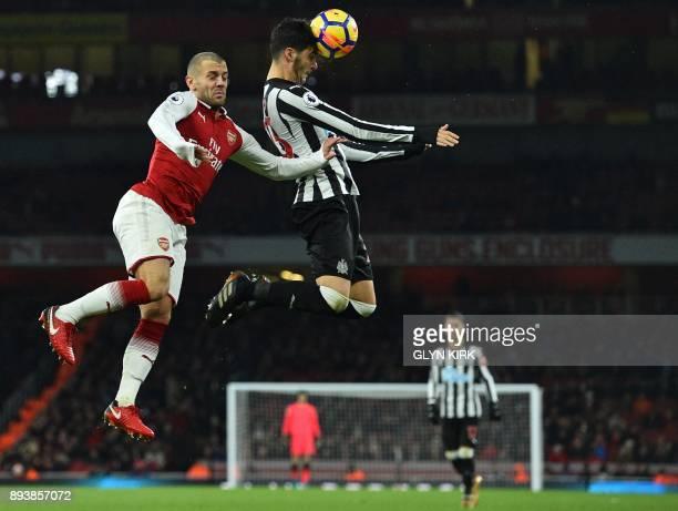 TOPSHOT Newcastle United's Spanish midfielder Mikel Merino heads the ball under pressure from Arsenal's English midfielder Jack Wilshere during the...