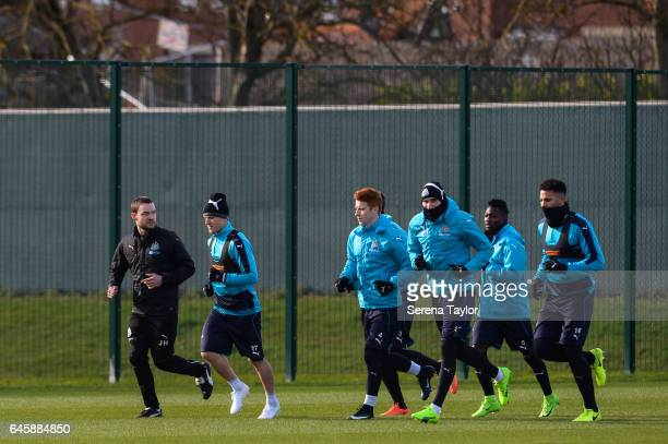 Newcastle United's Sports Scientist Jamie Harley leads players seen LR Matt Ritchie Jack Colback Jonjo Shelvey Christian Atsu and Jamaal Lascelles in...