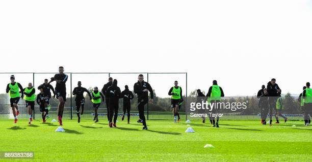 Newcastle Unitedâs Sports Scientist Jamie Harley takes the warm up during the Newcastle United Training session at The Newcastle United Training...