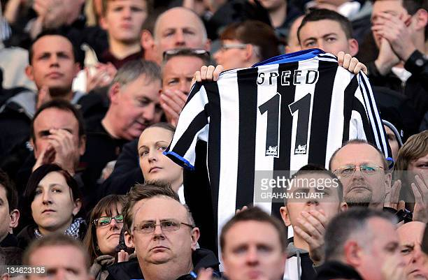 Newcastle United's supporter displays a shirt during the minute's applause for their former player and Wales manager Gary Speed who died last Sunday...