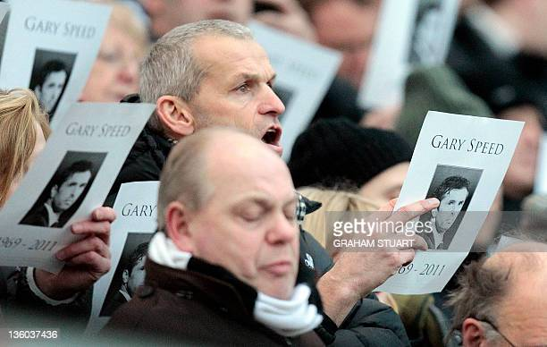 Newcastle United's supporters sing Bread of Heaven in tribute to their former player and Wales' manager the late Gary Speed before the English FA...