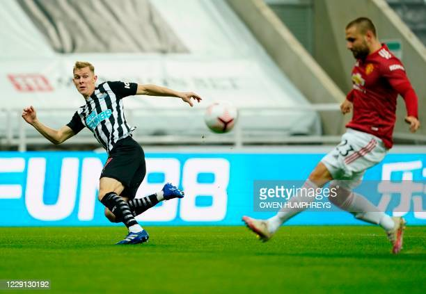 Newcastle United's Swedish defender Emil Krafth crosses the ball, which is then deflected for the first goal, during the English Premier League...