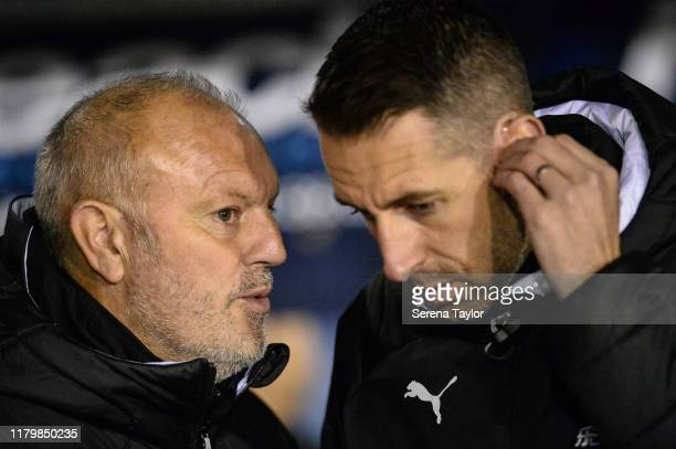 Newcastle United's Under 23 coach Neil Redfearn speaks with Newcastle's Head Coach Ben Dawson during the Leasingcom Cup match between Shrewsbury Town...