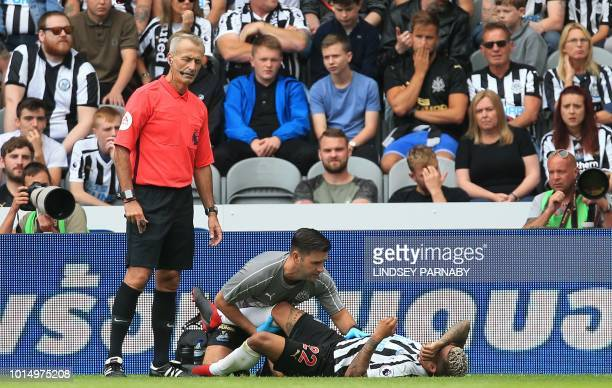 Newcastle United's US defender DeAndre Yedlin receives medical treatment during the English Premier League football match between Newcastle United...