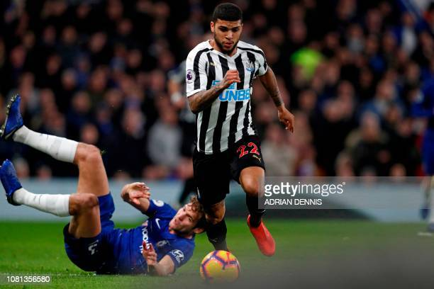 Newcastle United's US defender DeAndre Yedlin runs away from Chelsea's Spanish defender Marcos Alonso during the English Premier League football...