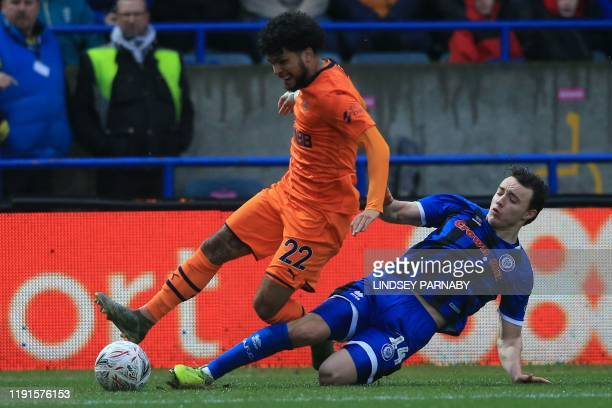 Newcastle United's US defender DeAndre Yedlin vies with Rochdale's English midfielder Oliver Rathbone during the English FA Cup third round football...
