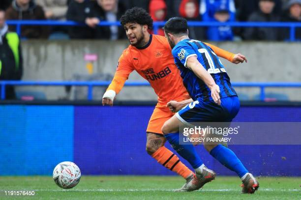 Newcastle United's US defender DeAndre Yedlin vies with Rochdale's Irish midfielder Jimmy Keohane during the English FA Cup third round football...