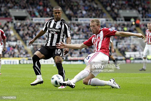 Newcastle United's Wayne Routledge vies with Stoke City's Welsh defender, Danny Collins during an English FA Premier League football match at St...