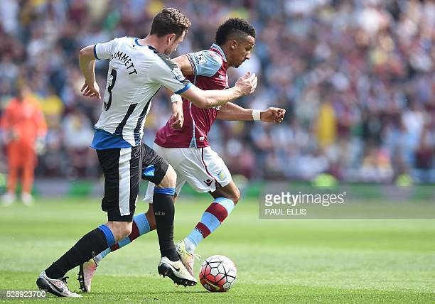 Newcastle United's Welsh defender Paul Dummett vies with Aston Villa's English midfielder Scott Sinclair during the English Premier League football...