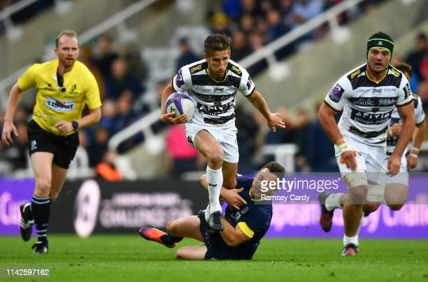 Newcastle Upon Tyne United Kingdom 10 May 2019 Arthur Retiere of La Rochelle is tackled by Greig Laidlaw of ASM Clermont Auvergne during the Heineken...