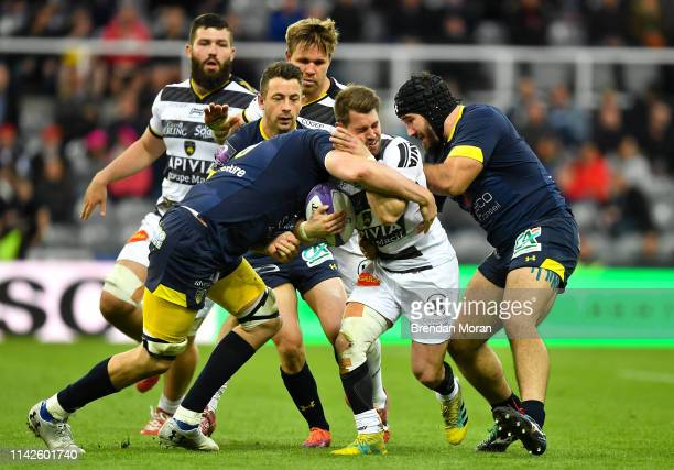 Newcastle Upon Tyne United Kingdom 10 May 2019 Arthur Retiere of La Rochelle is tackled by Etienne Falgoux and Arthur Iturria of ASM Clermont...