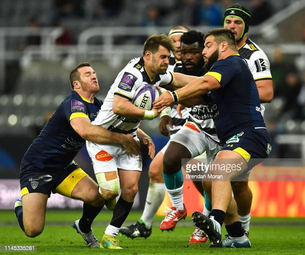 Newcastle Upon Tyne United Kingdom 10 May 2019 Arthur Retiere of La Rochelle is tackled by Camille Lopez and Rabah Slimani of ASM Clermont Auvergne...