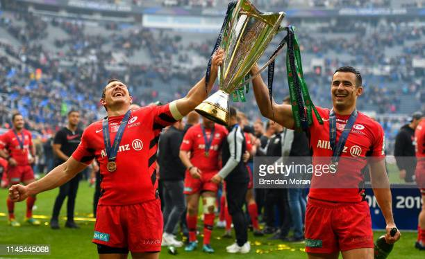 Newcastle Upon Tyne , United Kingdom - 11 May 2019; Alex Goode, left, and Sean Maitland of Saracens celebrate with the cup after the Heineken...