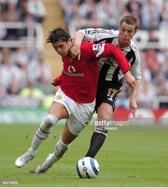 Manchester United's Cristiano Ronaldo vies with Newcastle United's Scott Parker during a Premiereship clash at St James' Park Newcastle United...