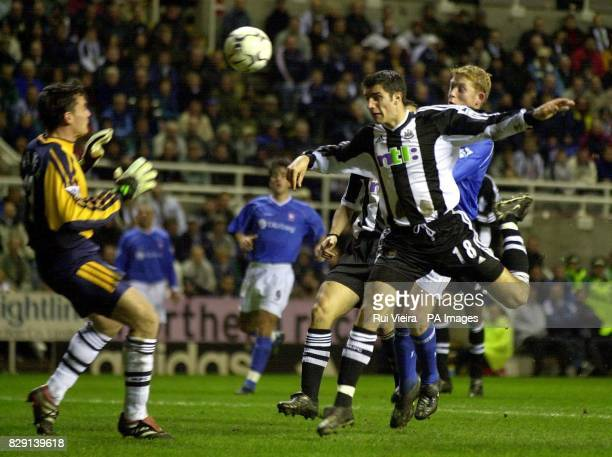 Newcastle's Aaron Hughes heads back to keeper Steve Harper under pressure from Ipswich's Alun Armstrong during the Worthington Cup fourth round game...