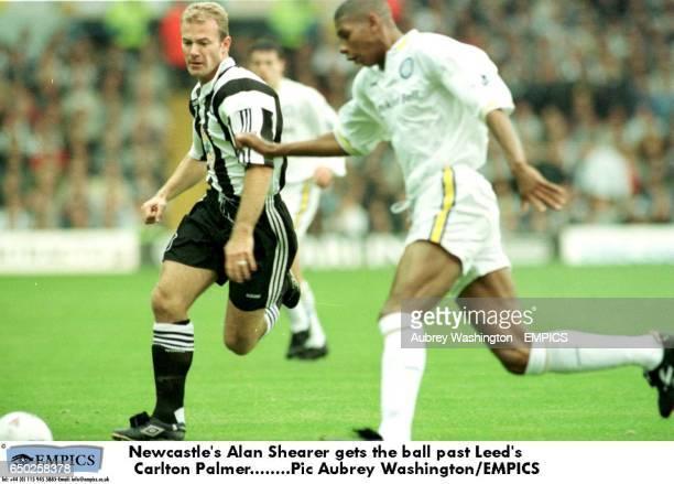 Newcastle's Alan Shearer gets the ball past Leed's Carlton Palmer