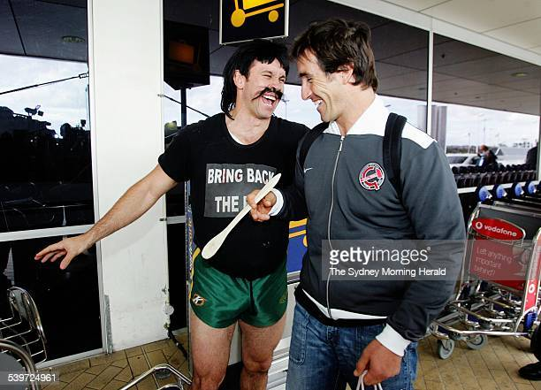 Newcastle's Andrew Johns was heading off to England to begin his stint with Super League Club Warrington Reg Reagan presents Andrew Johns a wooden...