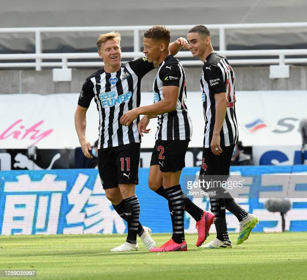 Newcastles Dwight Gayle celebrates after scoring the opening goal during the Premier League match between Newcastle United and Liverpool FC at St...