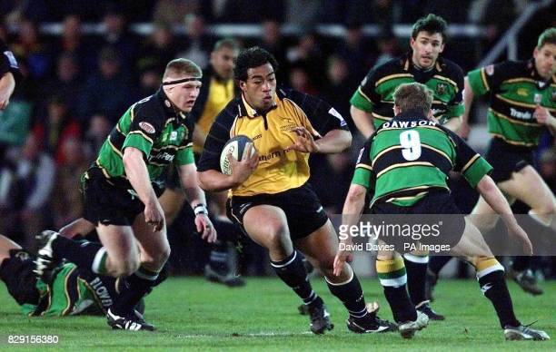 Newcastle's Epi Taione takes on Matt Dawson of Northampton during their Powergen Cup semifinal match at Northampton's Franklins Gardens ground