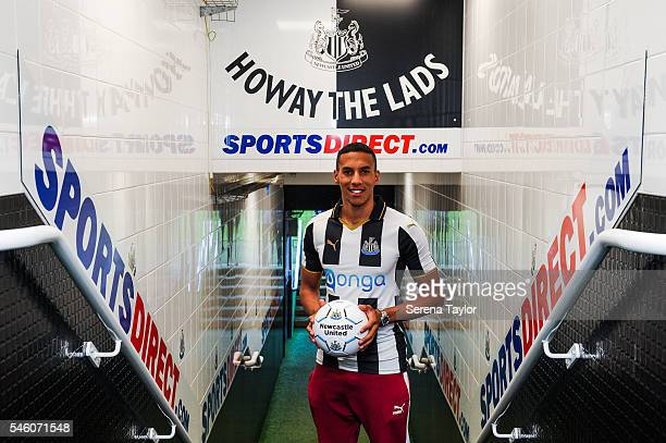 Newcastle's fifth summer signing Isaac Hayden poses for photographs in the tunnel holding a football at StJames Park on July 9 in Newcastle upon Tyne...