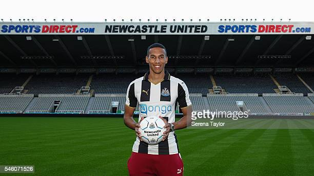 Newcastle's fifth summer signing Isaac Hayden poses for photographs pitch side holding a football at StJames Park on July 9 in Newcastle upon Tyne...