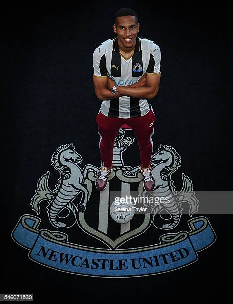 Newcastle's fifth summer signing Isaac Hayden poses for photographs with the club crest holding a football at StJames Park on July 9 in Newcastle...